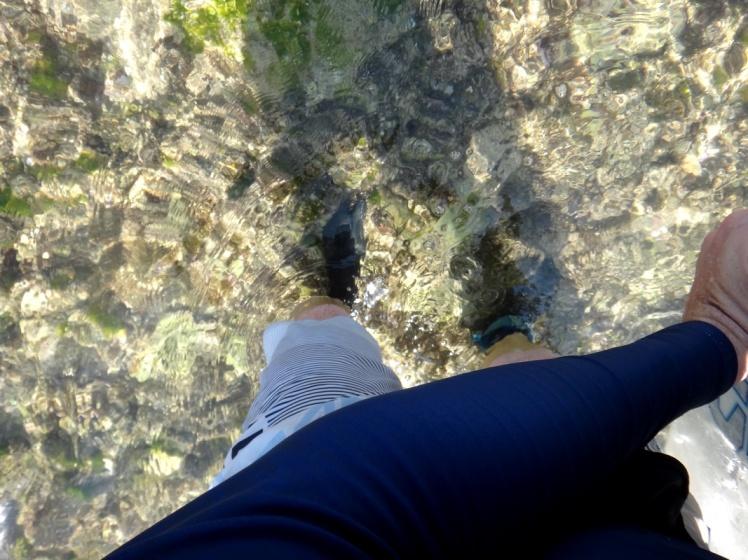 Entrada no mar caminhando sobre o Reef de Uluwatu